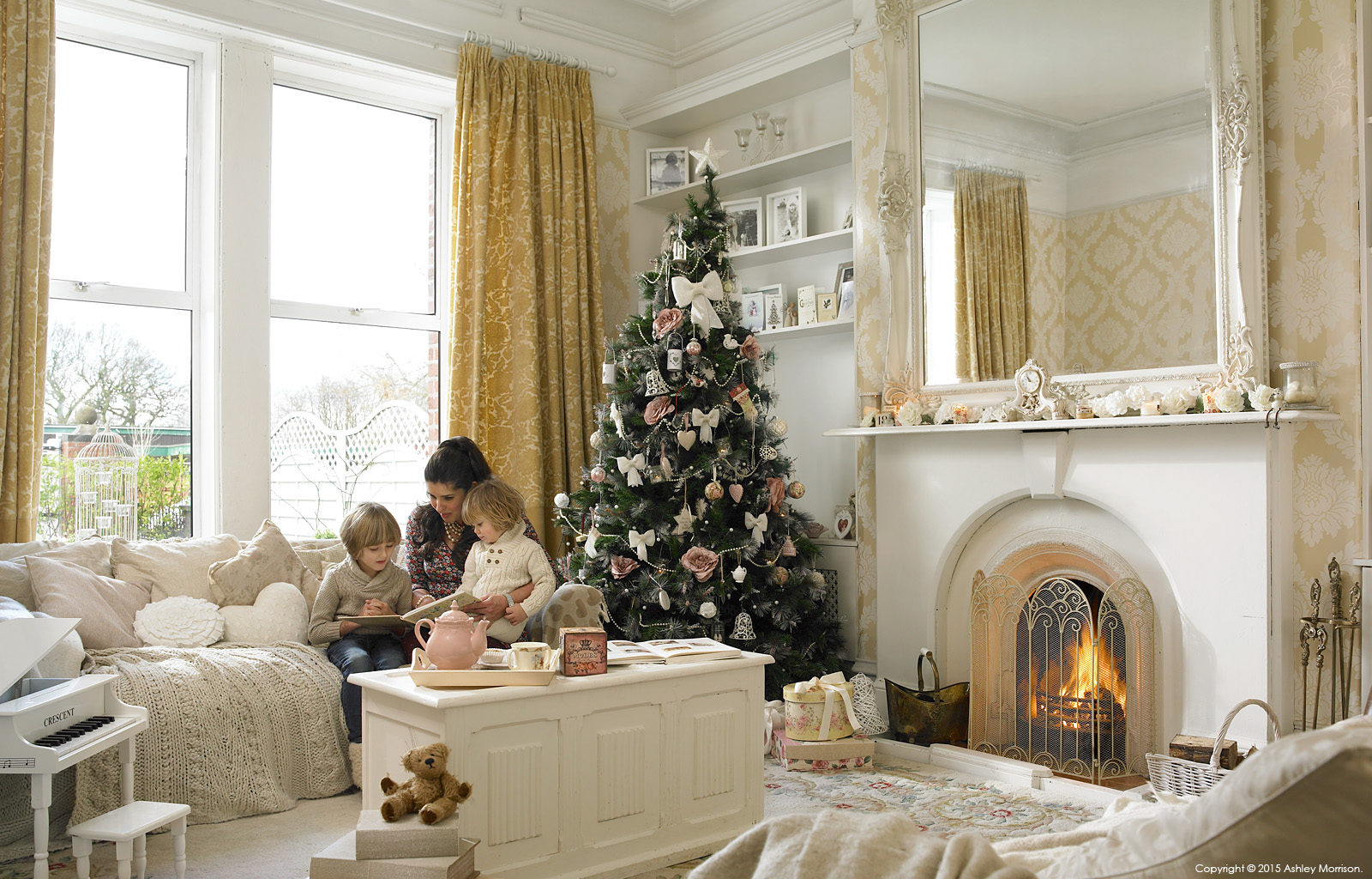 Amanda Cunningham with her two childern in the sitting room of their double fronted mid terrace house in Belfast at Christmas.