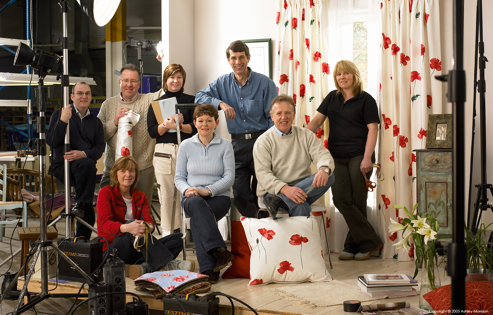 John Gallen and the Curtains-on-line team in front of the room set in their Londonderry factory by Ashley Morrison.