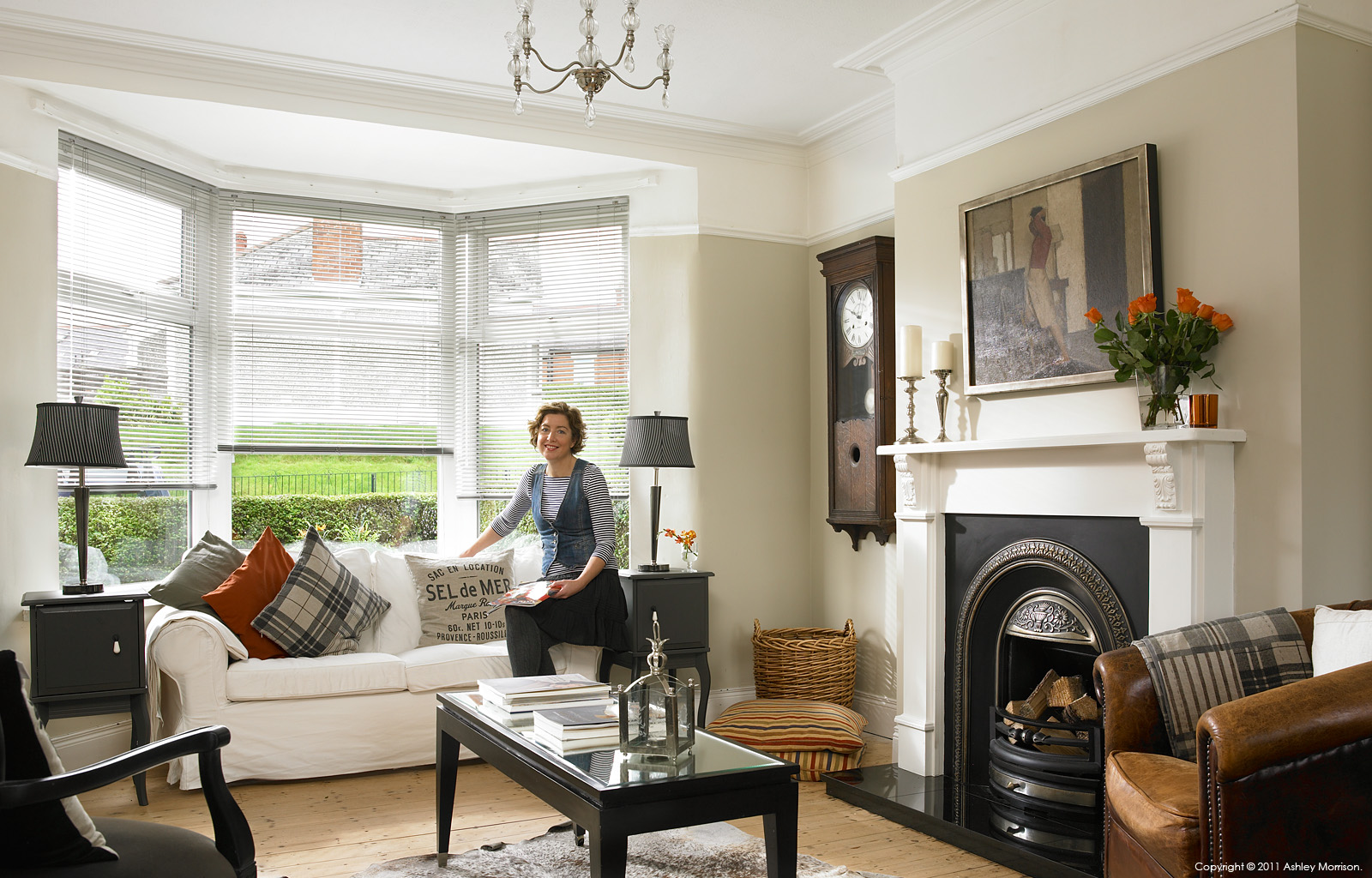 Janet Hamilton in the living room of her newly refurbished 1930s semi detached house in Belfast.