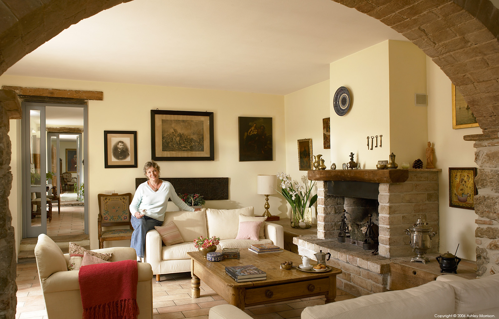 Helen Hannick in the sitting room of her 18th century Italian farmhouse near Amelia in Umbria.