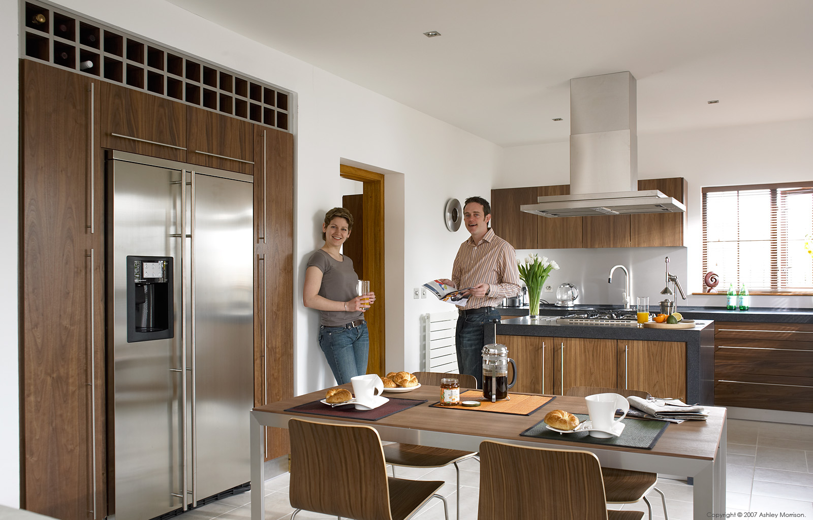 Vera Dengler and Patrick Murray in the kitchen of their semi detached house in a new development on the outskirts of Belfast.