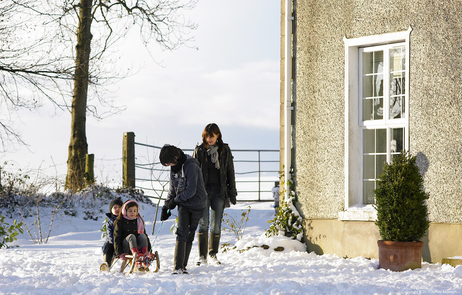 Nicola Nemec and her childern playing in the snow at their farmhouse near Armoy in Co Antrim.