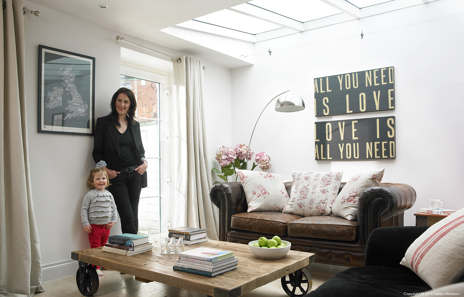 Kelly Ann Preston and her daughter Evie in the living room of their Victorian mid terrace townhouse in Belfast.