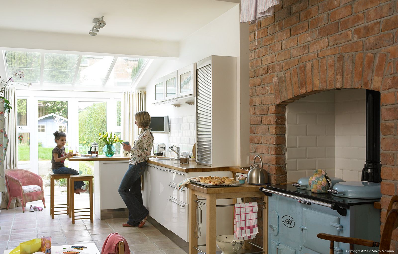 Kathy Reid & her daughter in the kitchen of their Edwardian semi-detached house in Belfast by Ashley Morrison.