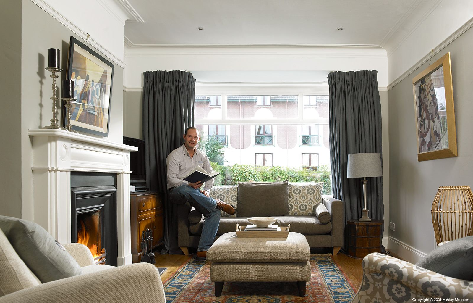 Andrew Webb in the sitting room of his semi detached house in the Belmont area of Belfast.