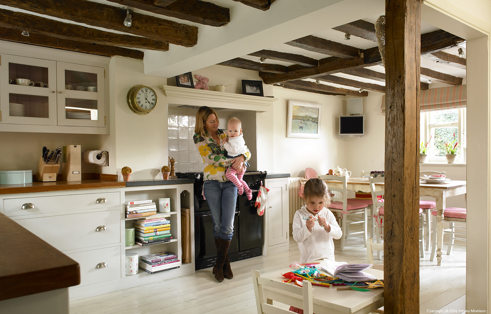 Sarah Bird with her daughters Millie and Darcey in the kitchen of their farmhouse near Shalford in Surrey by Ashley Morrison.