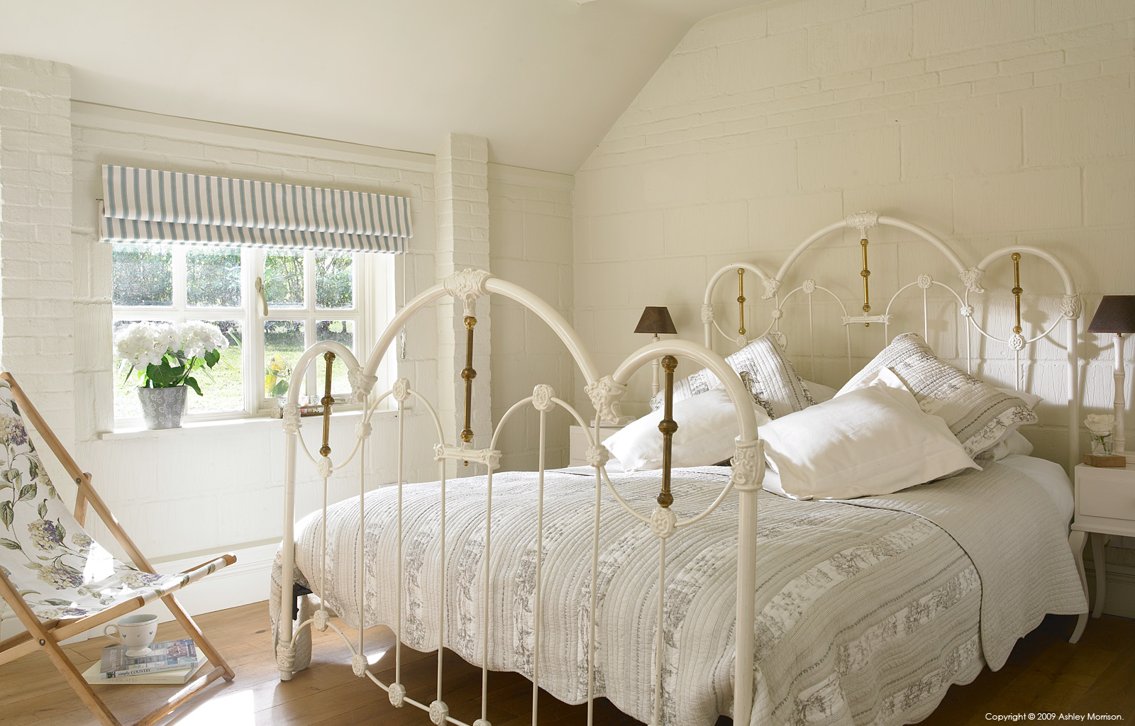 Guest bedroom in Beth & Jason Cooper's barn near Guildford in Surrey by Ashley Morrison.