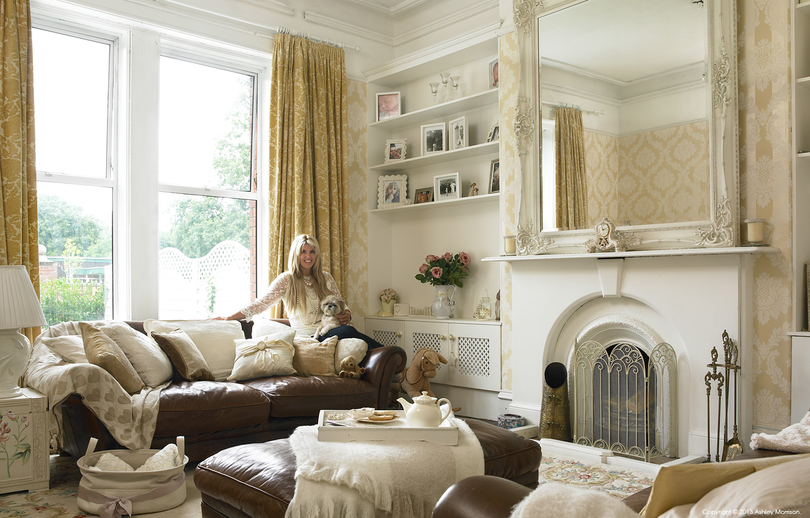 Amanda McGuile in the living room of her renovated double fronted mid terrace house in Belfast by Ashley Morrison.