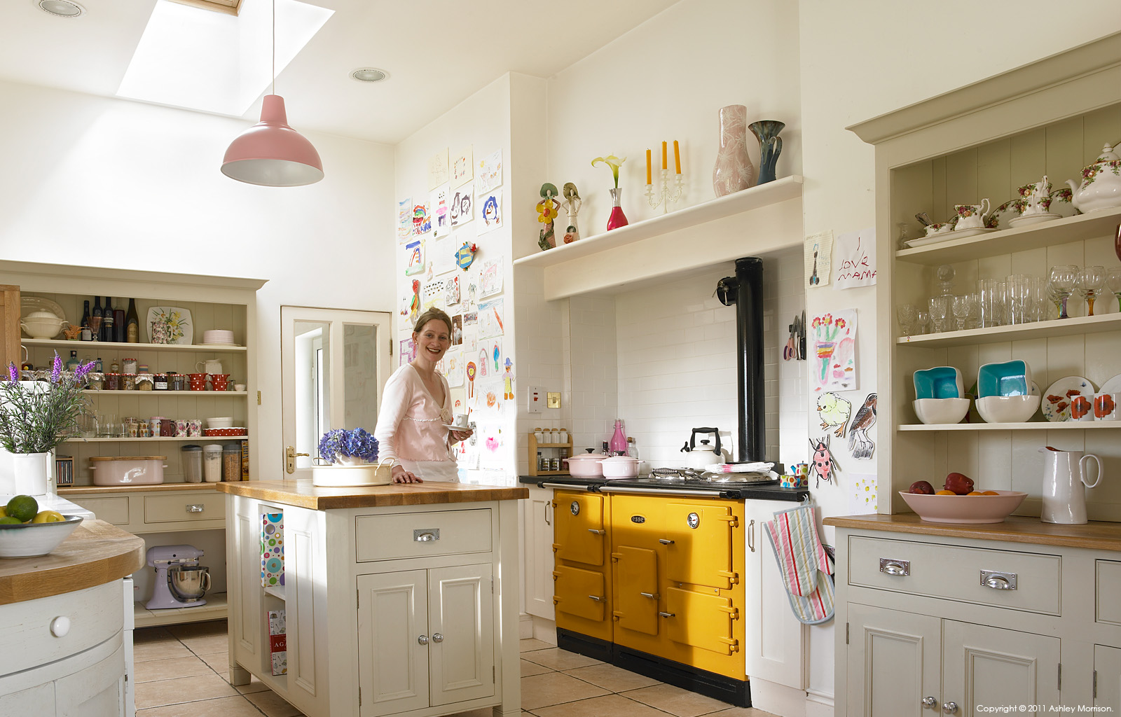 Brid ni Fhlathuin in the kitchen of her Irish cottage overlooking the Aran Islands in Connemara by Ashley Morrison.