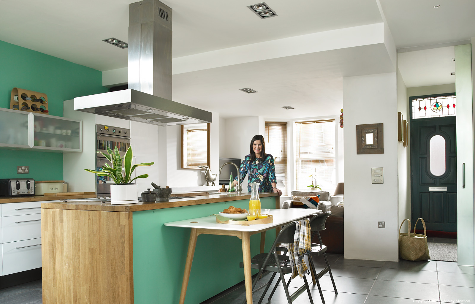 Siobhan McQuillan in the kitchen area of her semi detached home in Belfast.