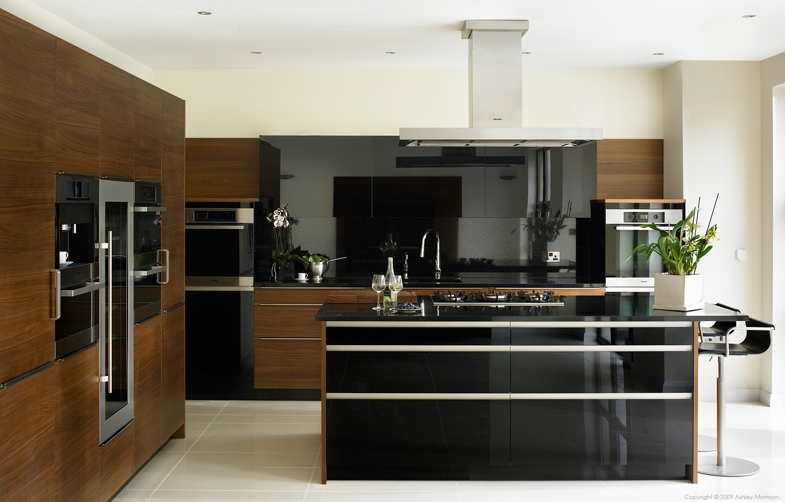 Black gloss and walnut kitchen by Robinson Interiors in a house near the County Down town of Comber.