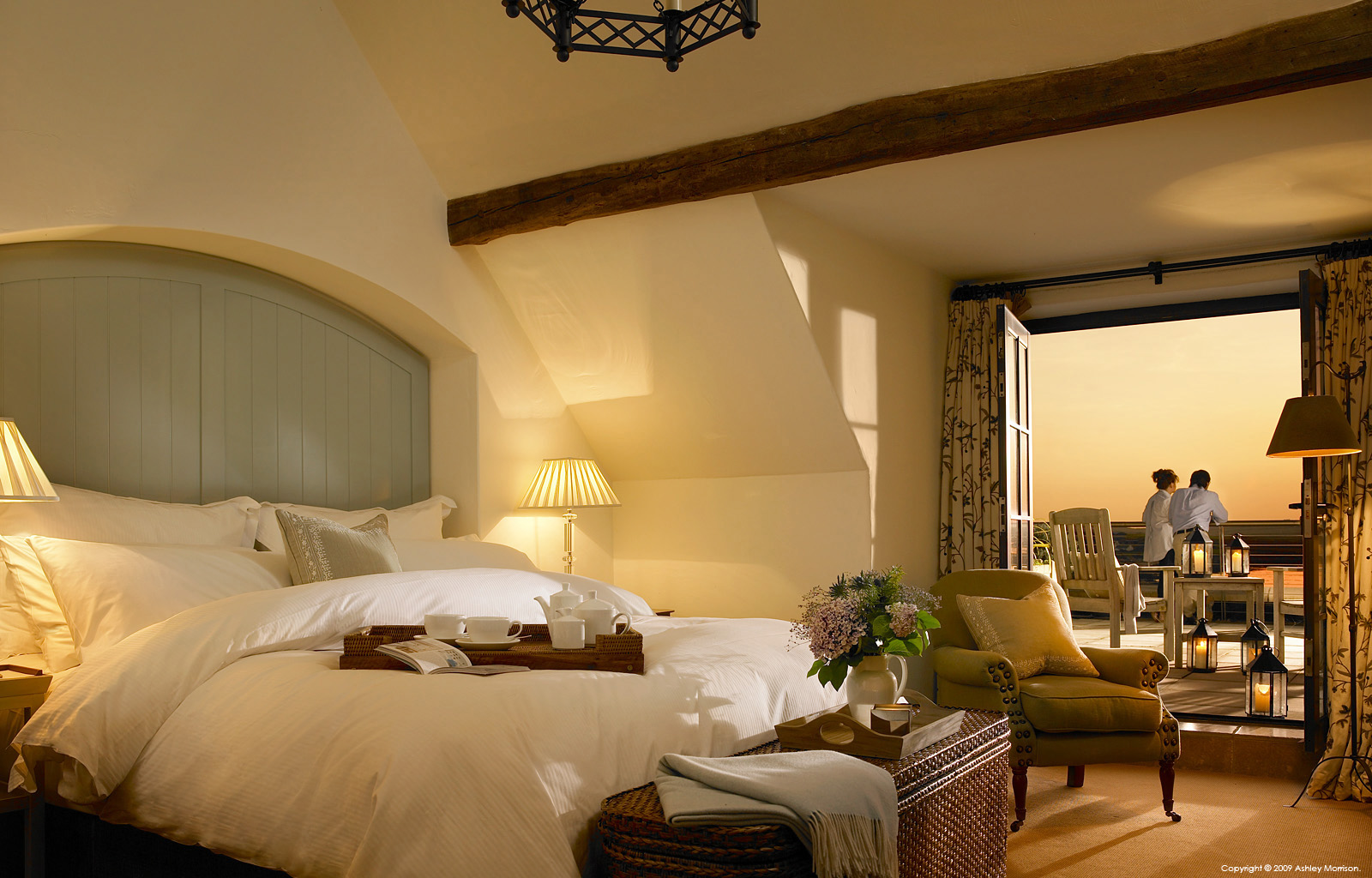 Bedroom suite in one of the Courtyard cottages at the Trump International Golf Links & Hotel in County Clare.