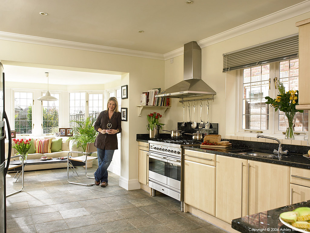 Lucy Alexander in the kitchen of her & Stewart Castledine's home near Thames Ditton in South West London by Ashley Morrison.