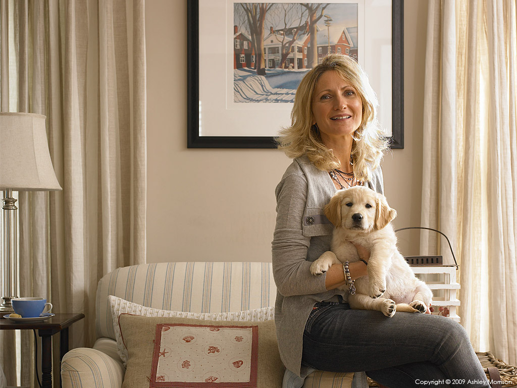 Sharon Cleland with her young puppy dog in the living room of her new-build house near Portstewart in County Londonderry.
