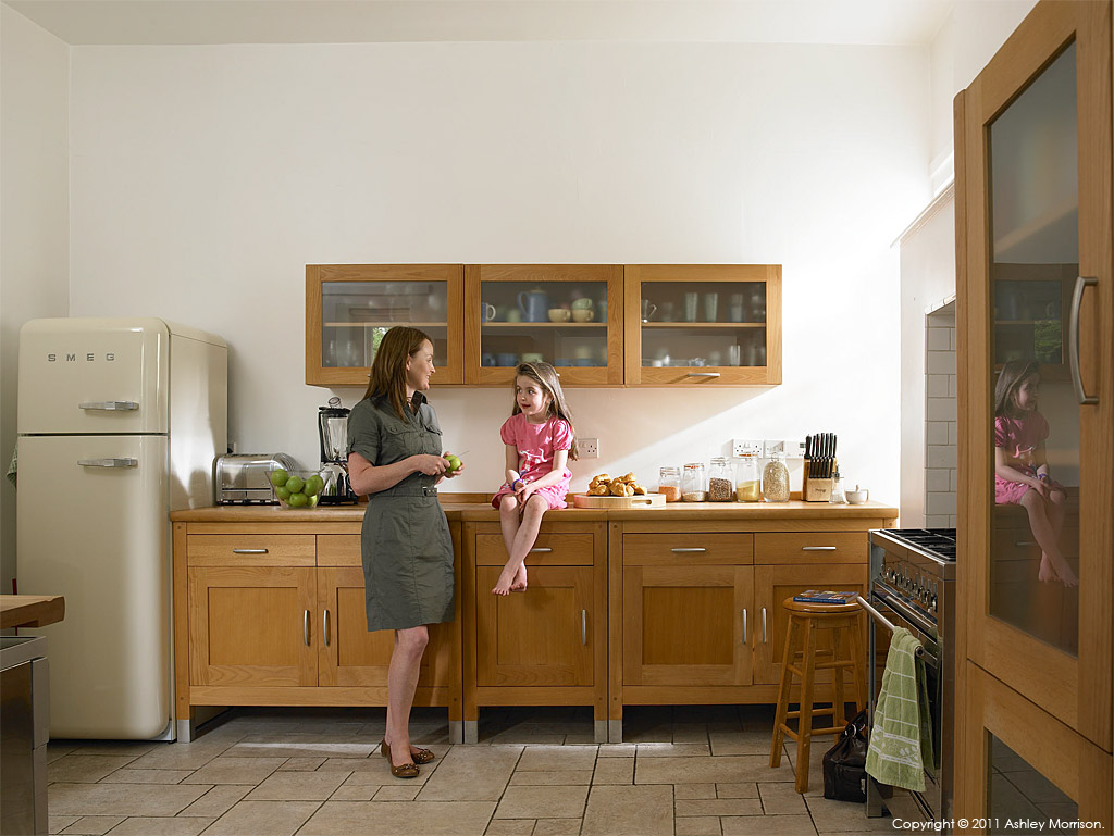 Briege Conway and her daughter in the kitchen of their Victorian townhouse in the County Antrim coastal town of Cushendall.