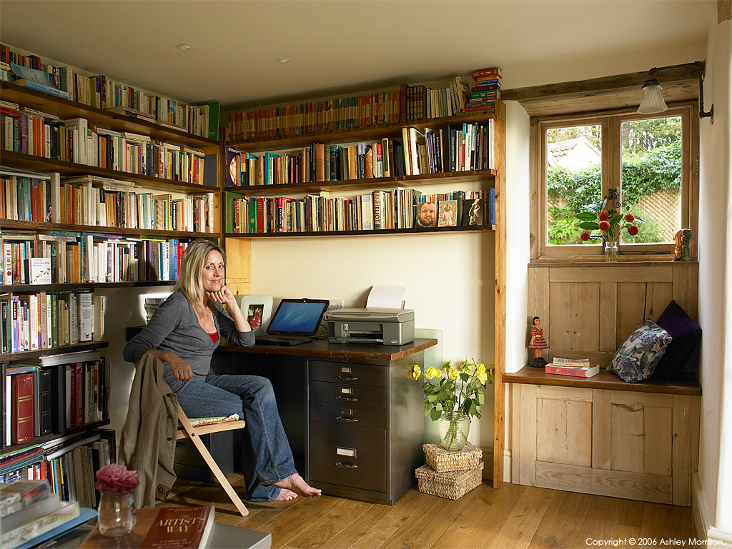 Julie-Christian Young in the library of her stone farmhouse near Bath by Ashley Morrison.